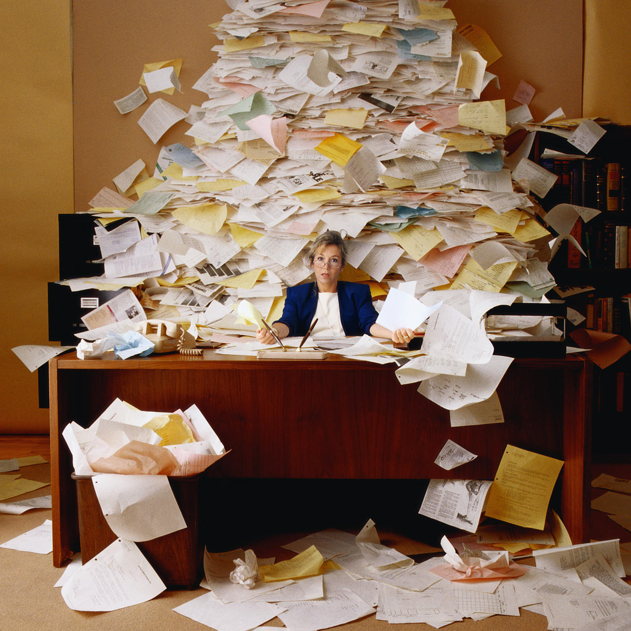 20141010 woman in the office overwhelmed with paper