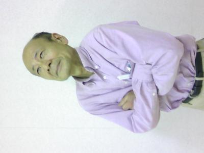 田口さん腕組み