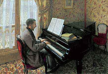 ピアノを弾く若い男
