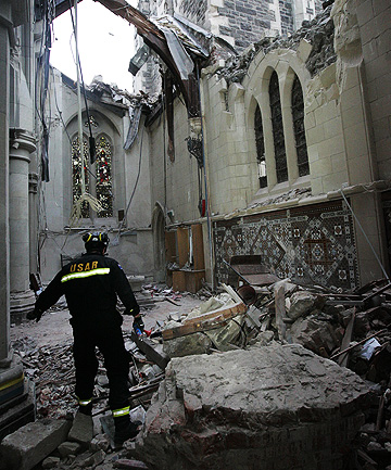 IN RUINS A member of a New Zealand Urban Search and Rescue team examines an area of the inside of Christ Church Cathedral.