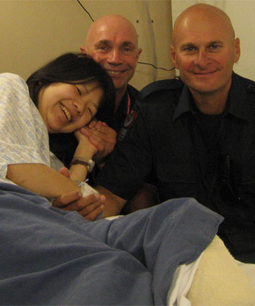 I TRUST YOU Japanese student Norika Masutani, visited in hospital by firefighters Paul Rodwell and Terry Gyde, who rescued her from the ruins of the CTV building.