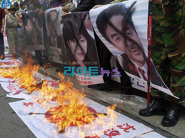 韓国デモ 自民議員にばってん