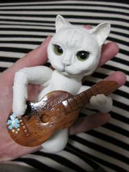 猫人形・ギター