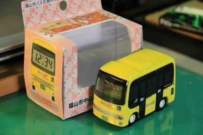 2010-09-01_EOS 7D_4476、2010.9.1.、福山市バス交通利用促進協議会、「福山市中心部循環バス・まわローズ」、『走る!光る!鳴る!バス型目覚まし時計』、2