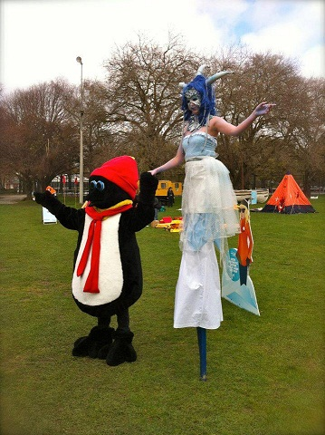 Penguin and his very tall gal pal!